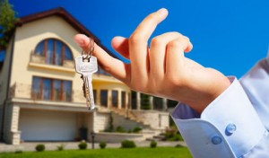 House owner/real estate agent giving away the keys